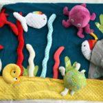 Le tapis à histoire de Petit Poisson Blanc : le tapis des Bobines